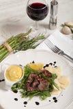 Beef on arugula salad and parmesan Royalty Free Stock Photo