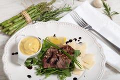 Beef on arugula salad and parmesan Stock Image