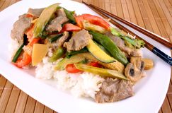 Beef with Asian vegetables, rice, mushrooms and peanut sauce Stock Photography