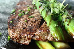 Beef with asparagus 1. Grilled Beef with asparagus as a main course Royalty Free Stock Images