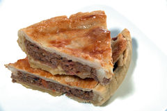 Beef and bacon meat pie. The traditonal aussie meat pie with bacon and onion Royalty Free Stock Photos