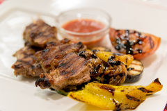 Beef baked on  grill with vegetables at  plate Stock Photo