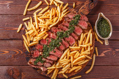 Beef barbecue ribeye steak with chimichurri sauce and french fri stock images