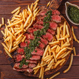Beef barbecue ribeye steak with chimichurri sauce and french fri Royalty Free Stock Photography