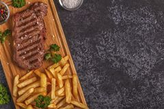 Beef barbecue steak with french fries. Royalty Free Stock Images