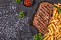 Beef barbecue steak with french fries. royalty free stock photos