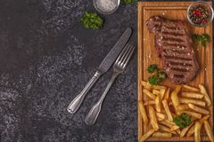 Beef barbecue steak with french fries. stock images