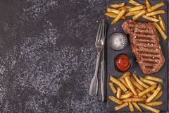 Beef barbecue steak with french fries. royalty free stock photography