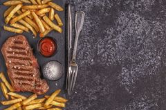 Beef barbecue steak with french fries. Stock Photos