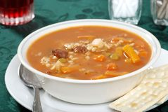 Beef barley soup focus on front bowl rim Stock Photography