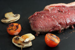 Beef being cooked in a grill Stock Images