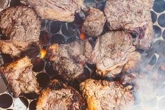 Beef being prepared on the grill. Photo of Brazil stock image