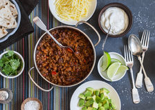 Beef and black bean chili bar on dark background, top view. Stock Image