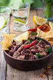 Beef and black bean chili served with corn tortilla chips Royalty Free Stock Images
