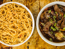 Beef and Black Bean Sauce With Red Peppers And Egg Noodles Stock Image