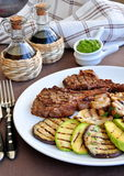 Beef on a bone with vegetables grill Stock Photos