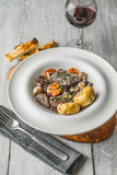 Beef bourguignon in a ceramic dish on stand Royalty Free Stock Image