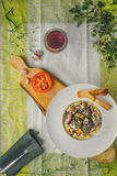 Beef bourguignon in a ceramic plate, tablecloth, flowers, cloth Stock Image