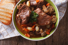 Beef Bourguignon close up in a bowl on the table. horizontal top Royalty Free Stock Photography