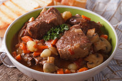 Beef Bourguignon with mushrooms close up in a bowl. horizontal Stock Images