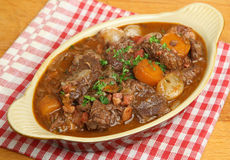 Beef Bourguignon Stew in Serving Dish Stock Images