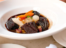 Beef bourguignon with vegetables royalty free stock images