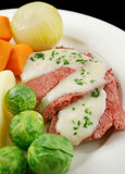 Beef Brisket With Bechamel Sauce. Delicious sliced corn beef with bechamel sauce and vegetables stock images