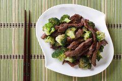 Beef with broccoli and chopsticks. horizontal view from above Stock Photos