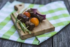 Beef brochettes with tomatos Royalty Free Stock Image