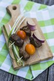 Beef brochettes with tomatoes and red oignons Royalty Free Stock Photography