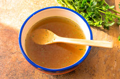 Beef broth with herbs Stock Photos
