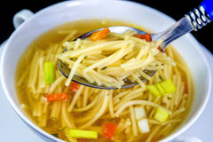 Beef broth with noodles Royalty Free Stock Photos