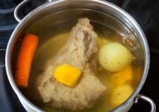 Beef broth in open pan Royalty Free Stock Photo
