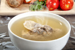 Beef broth with a piece of veal Royalty Free Stock Photos