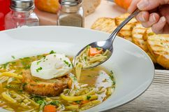 Beef broth with toast and egg benedict Royalty Free Stock Photo