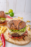 Beef burger with avocado dip royalty free stock photos