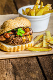 Beef burger with bacon, cheddar, homemade fries Stock Photo