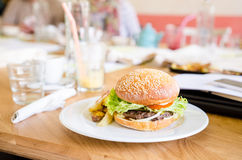 Beef burger with bacon, cheese and potatoes Stock Photo