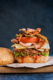 Beef burger and bacon Royalty Free Stock Photography