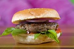 Beef burger in a bread bun Stock Image