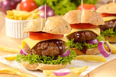 Beef burger. S with cheese and vegetables.Selectiv e focus on the front burger Royalty Free Stock Photo
