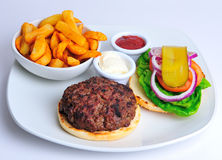 Beef burger and chips. With salad stock photo