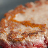 Beef burger cooked on a black pan macro still Stock Image