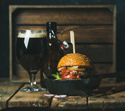 Beef burger with crispy bacon, vegetables and beer Stock Photography