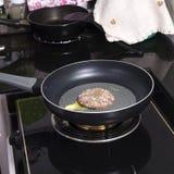 Beef Burger deep fried in the pan Stock Photos