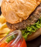 Beef Burger Dinner Means Quarter Pounder And Bun royalty free stock images