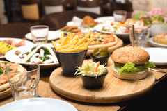 Beef burger and french fries & other plates Stock Images