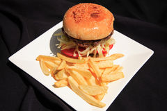 Beef burger with fries Stock Images