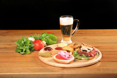 Beef burger on a plate with vegetables Royalty Free Stock Image