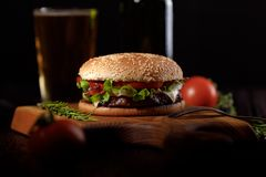 Beef burger ready to eat with beer. stock photos